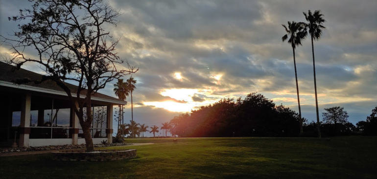 The sun sets in view of the clubhouse at Manatee Golf Course